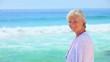 Mature woman looking at the sea