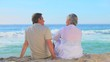 Mature couple relaxing sitting on a beach