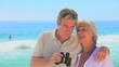Mature couple using binoculars