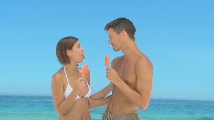 Attractive couple eating water ices