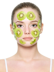 Fruit facial mask on female face
