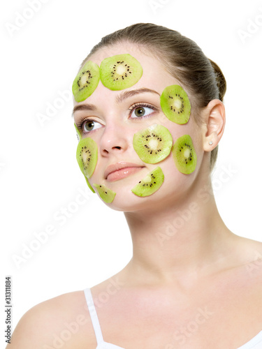 Woman with a kiwi mask on a face
