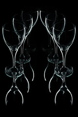 Glass wine glasses on a black background