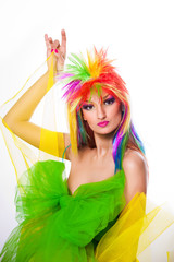 woman with multicolored wig and green dress