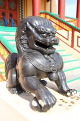 Lions guard the entrance to a Buddhist temple