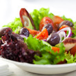 Delicious vegetable salad with marinated greek olives