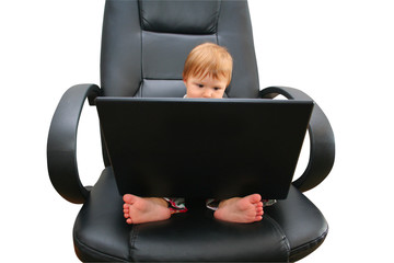 little girl with a laptop on a chair
