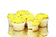 Yellow cupcakes on white