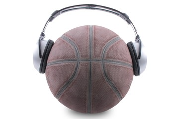Basketball ball on white background with big .headphones.
