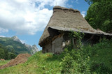 Landscape with a wooden house in Transylvania, Romania poster