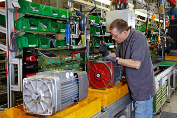 skilled industrial worker, mounting electric motors