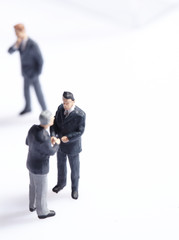 Business figurines standing