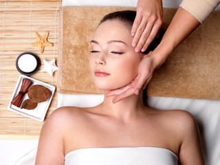 Pamering and massage for face of woman