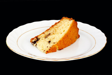 Slice of cake on black background