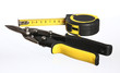 Construction tools: snips and tape measure