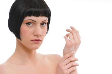 young beautiful woman applying hands cream