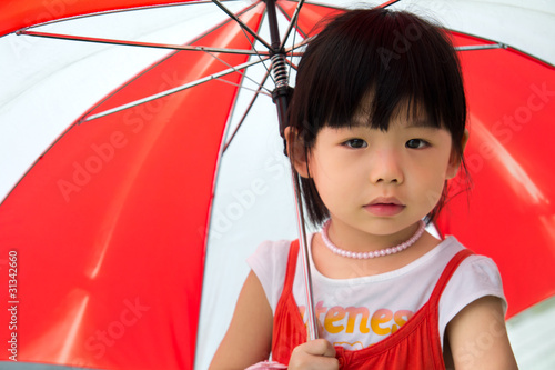 Asian child with red umbrella