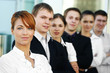 Six young and smart business persons are standing in a row