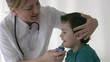 Pediatrician checking Little boy