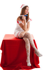 Young sexy nurse with a disposable syringe