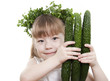 Little girl holds the fresh cucumbers, isolated
