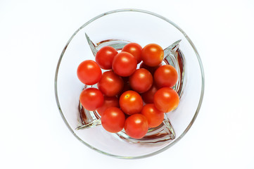Red tomatoes in a transparent plate
