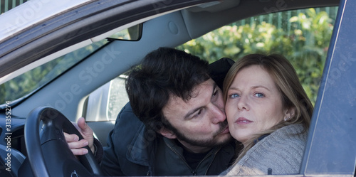 Young Adult Couple with Car