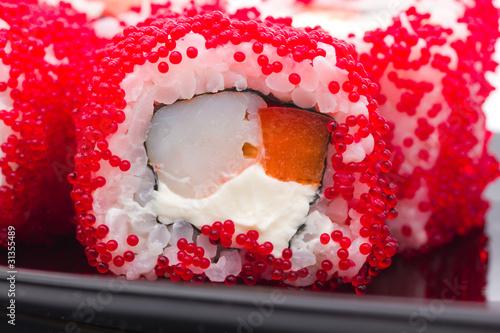 Fototapeta sushi with red caviar..