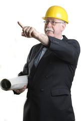 Senior architect holding blueprints and pointing