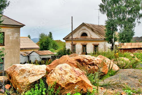 Big boulders near a small house