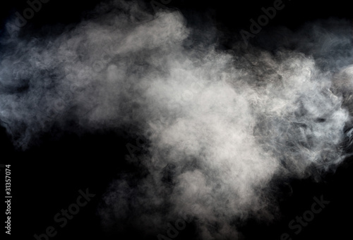 White smoke on black background. Isolated.