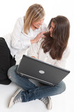 Laughing young women with laptop