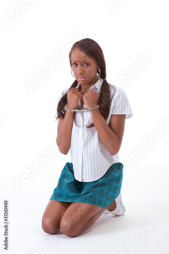 handcuffs on African American woman in sexy uniform