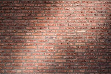 Brick wall with flush joints in dramatic lighting