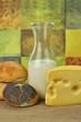 milk bottle , cheese and fresh rolls