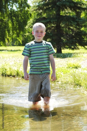 Boy Standing In The Water