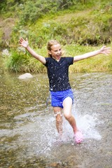 Girl Running Through Water
