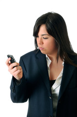 young brown woman looking angry the display of her mobile