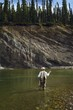Man Fly Fishing In Mountain River