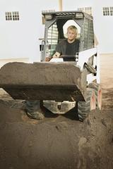 Man Operating Small Digger