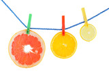 Juicy orange, grapefruit and lemon hanging on the rope