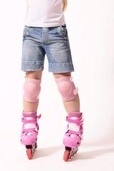 Roller skates on the skater legs