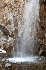 Falls in the snow in the spring. Kegety canyon in Asia, Kyrgyzst