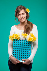 .Portrait of young female with bunch of flowers in paper-bag