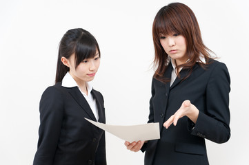 two asian businesswomen working