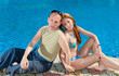 Attractive couple has a rest at pool