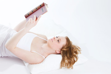 young beautiful girl reads book