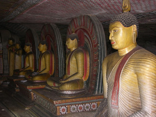 Ancient statues of the Buddha in the Cave Temple, Dambulla, Shri