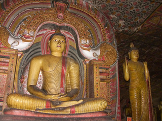 Ancient statues of the Buddha in the Cave Temple, Dambulla