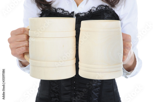 beautiful woman holds a large wooden beer mug.